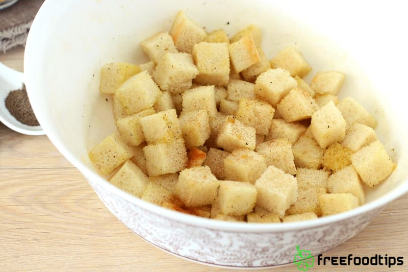 Combine seasoning with bread cubes
