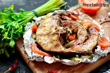 Baked catfish steak with vegetables