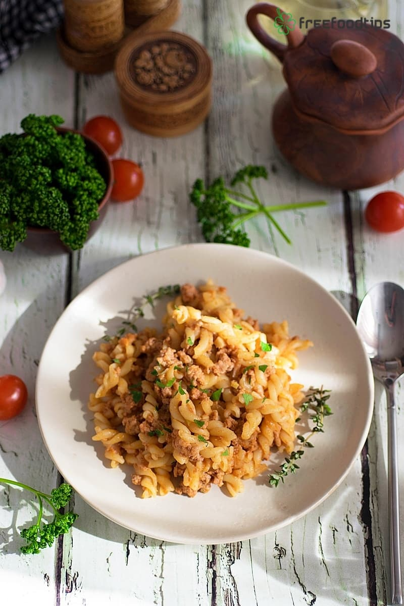 Rotini pasta with minced meat and tomato sauce