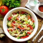 Cabbage slaw with cucumber and tomato