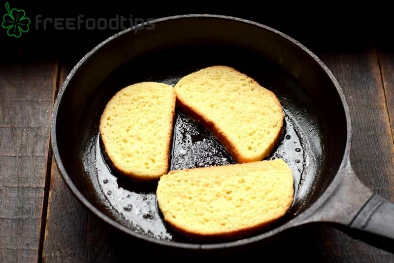 Place bread slices in the hot skillet