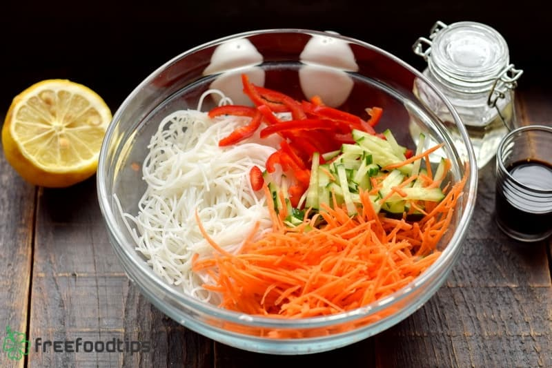 Place vegetables and noodles in a deep bowl