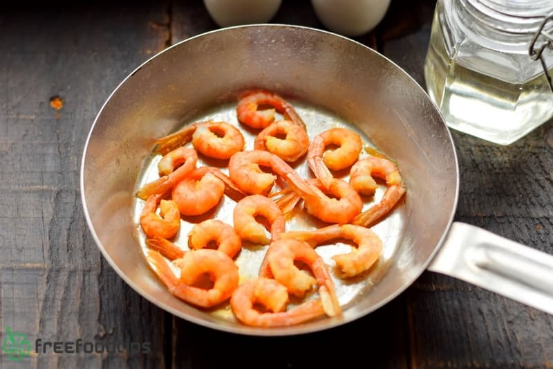 Fry shrimps in the skillet until golden brown