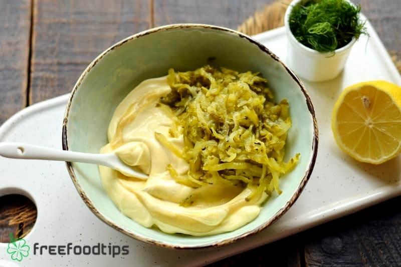 Add grated pickled cucumber