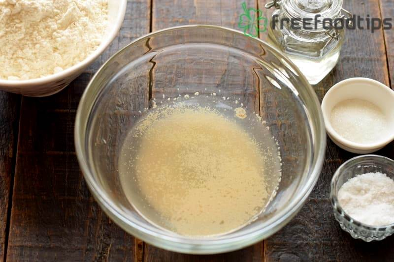 Combine yeast with warm water