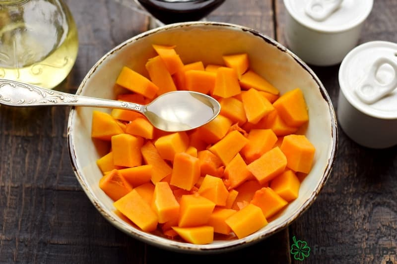 Cut squash into cubes cover them in oil