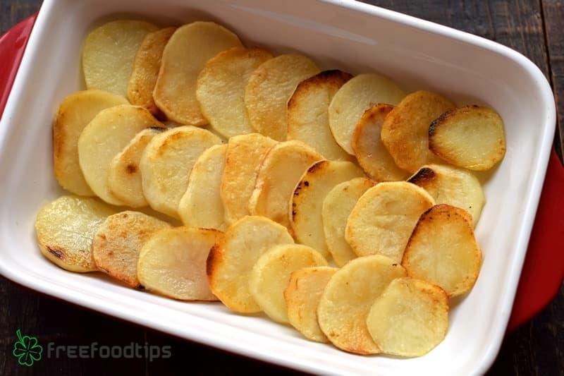 Layer fried potato slices