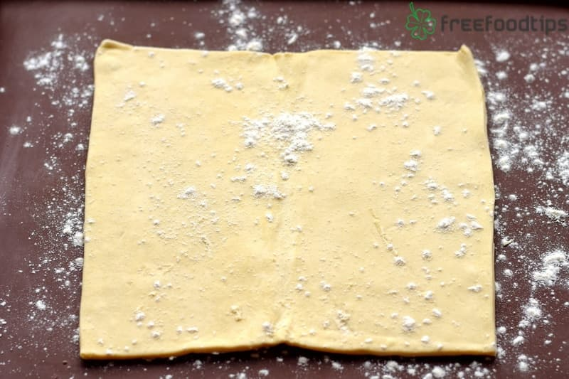 Sprinkle flour over the puff pastry sheet