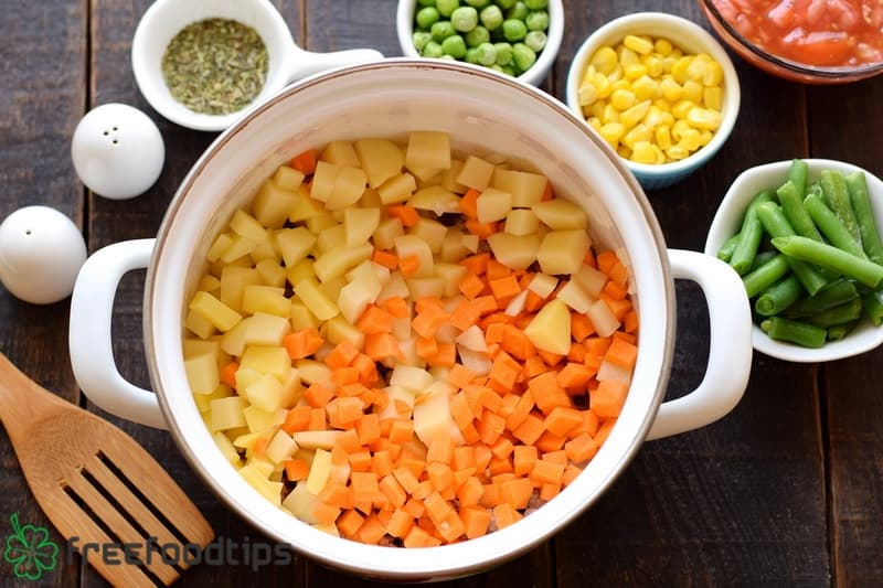 Add cubed potato and carrot to the pot