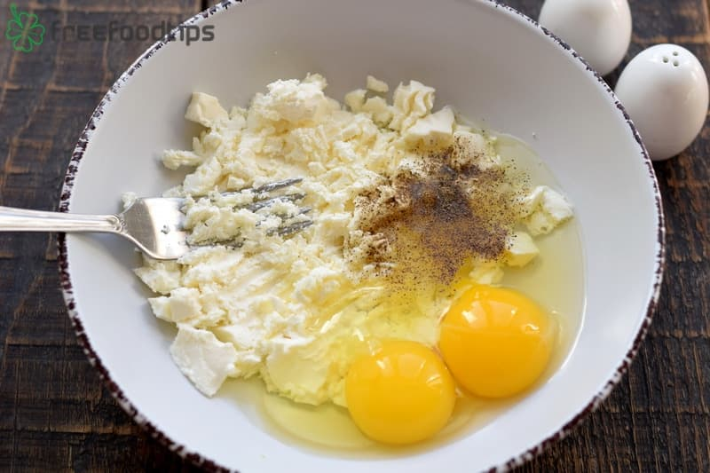 Combine eggs with feta and black pepper
